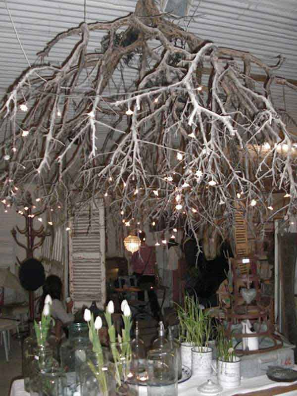 22 diy ideas for rustic tree branch chandeliers world - Tree branch ceiling light ...