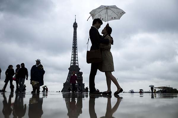 Paris, France: People gather in front of the Eiffel Tower