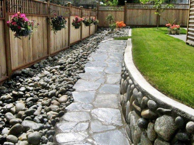 backyard-with-beautiful-river-rocks1-634x476